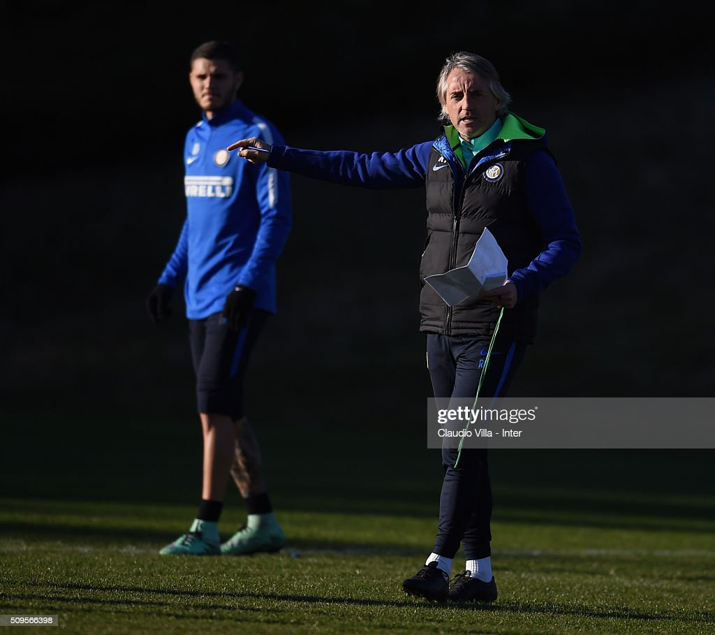 Head coach FC Internazionale <a gi-track='captionPersonalityLinkClicked' href=/galleries/search?phrase=Roberto+Mancini&family=editorial&specificpeople=234429 ng-click='$event.stopPropagation()'>Roberto Mancini</a> reacts during the FC Internazionale training session at the club's training ground at Appiano Gentile on February 11, 2016 in Como, Italy.