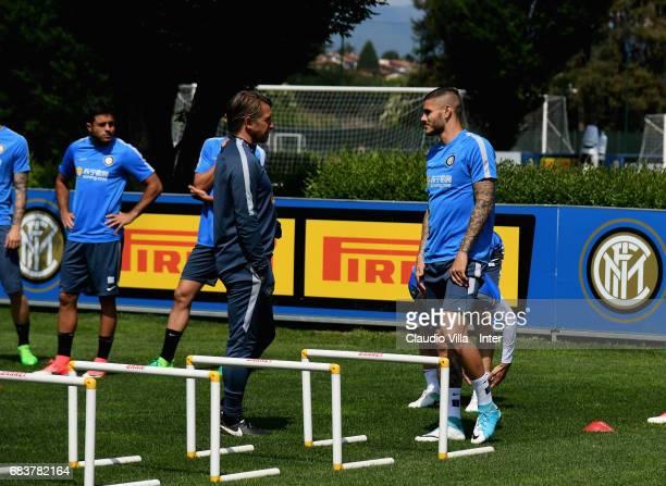 Head coach FC Internazionale Stefano Vecchi and Mauro Icardi of FC Internazionale chat during FC Internazionale training session at Suning Training...