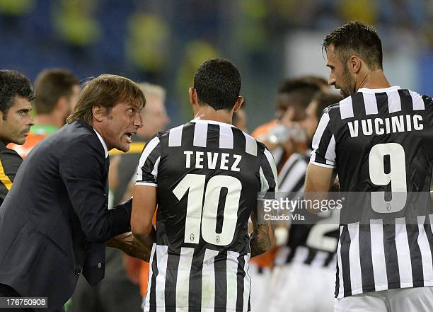 Head coach FC Juventus Antonio Conte Carlos Tevez and Mirko Vucinic during the TIM Supercup match between SS Lazio and FC Juventus at Olimpico...