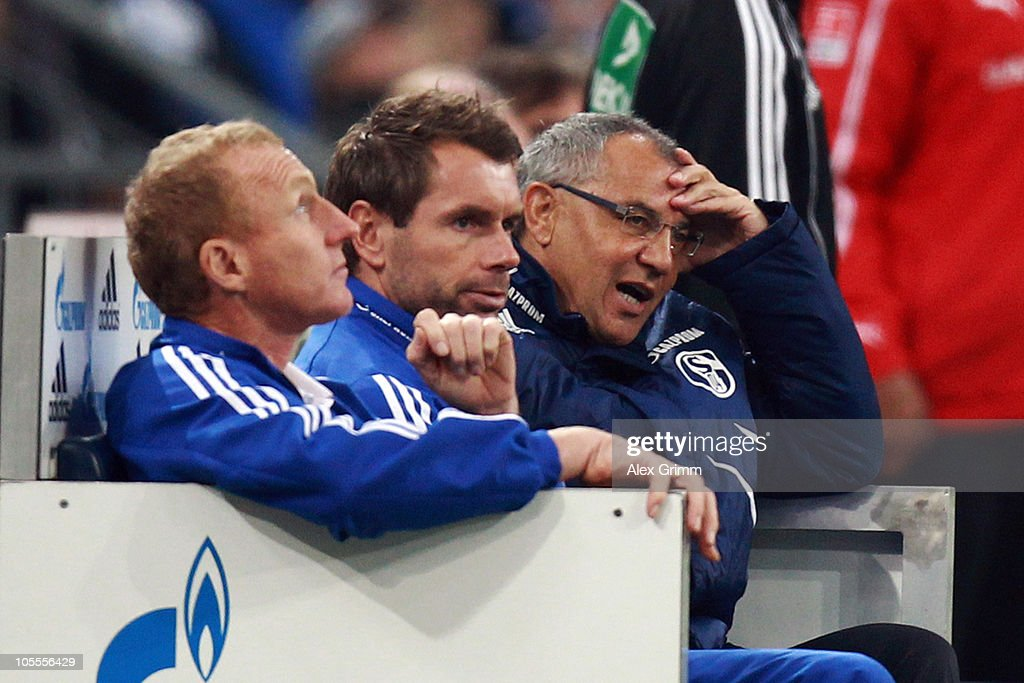 Head coach <a gi-track='captionPersonalityLinkClicked' href=/galleries/search?phrase=Felix+Magath&family=editorial&specificpeople=206318 ng-click='$event.stopPropagation()'>Felix Magath</a> and his assistants <a gi-track='captionPersonalityLinkClicked' href=/galleries/search?phrase=Bernd+Hollerbach&family=editorial&specificpeople=2057054 ng-click='$event.stopPropagation()'>Bernd Hollerbach</a> and Seppo Eichkorn (R-L) of Schalke react during the Bundesliga match between FC Schalke 04 and VfB Stuttgart at the Veltins Arena on October 16, 2010 in Gelsenkirchen, Germany.