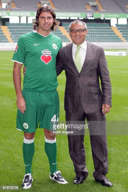 Head coach Felix Magath and new arrival Andrea Barzagli pose during the Bundesliga 1st Team Presentation of VfL Wolfsburg at the Volkswagen Arena on...