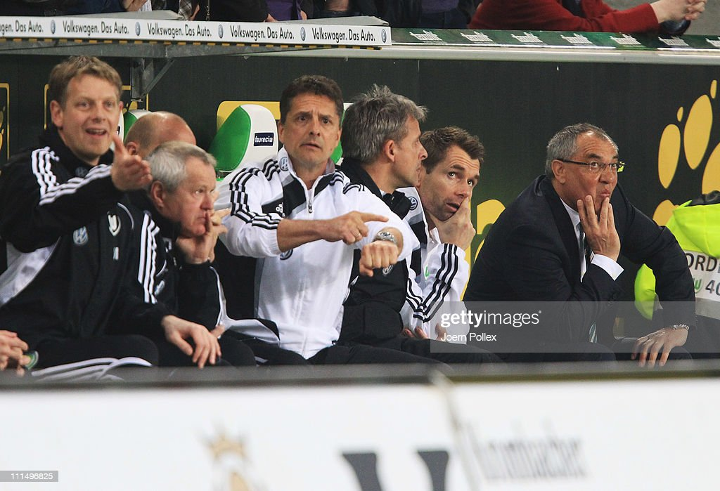 Head coach <a gi-track='captionPersonalityLinkClicked' href=/galleries/search?phrase=Felix+Magath&family=editorial&specificpeople=206318 ng-click='$event.stopPropagation()'>Felix Magath</a> (R), asisstent coach <a gi-track='captionPersonalityLinkClicked' href=/galleries/search?phrase=Bernd+Hollerbach&family=editorial&specificpeople=2057054 ng-click='$event.stopPropagation()'>Bernd Hollerbach</a> (2nd R) and Assistent coach <a gi-track='captionPersonalityLinkClicked' href=/galleries/search?phrase=Pierre+Littbarski&family=editorial&specificpeople=821525 ng-click='$event.stopPropagation()'>Pierre Littbarski</a> (3rd R)of Wolfsburg are seen during the Bundesliga match between VfL Wolfsburg and Eintracht Frankfurt at Volkswagen Arena on April 3, 2011 in Wolfsburg, Germany.
