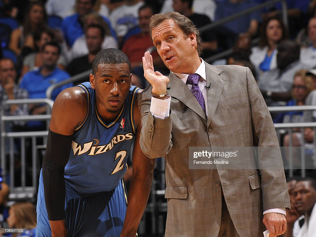 Head coach Flip Saunders instructs John Wall of the Washington Wizards during the game against the Orlando Magic on October 28 2010 at Amway Center...