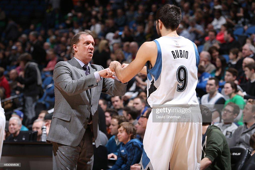 Head coach Flip Saunders of the Minnesota Timberwolves fist bumps Ricky Rubio of the Minnesota Timberwolvesduring the game against the Atlanta Hawks...