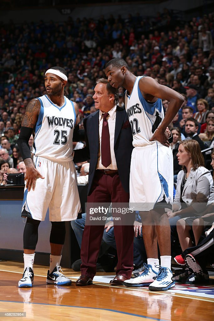 Head Coach Flip Saunders of the Minnesota Timberwolves talks with Mo Williams and Andrew Wiggins during the game against the Chicago Bulls on...