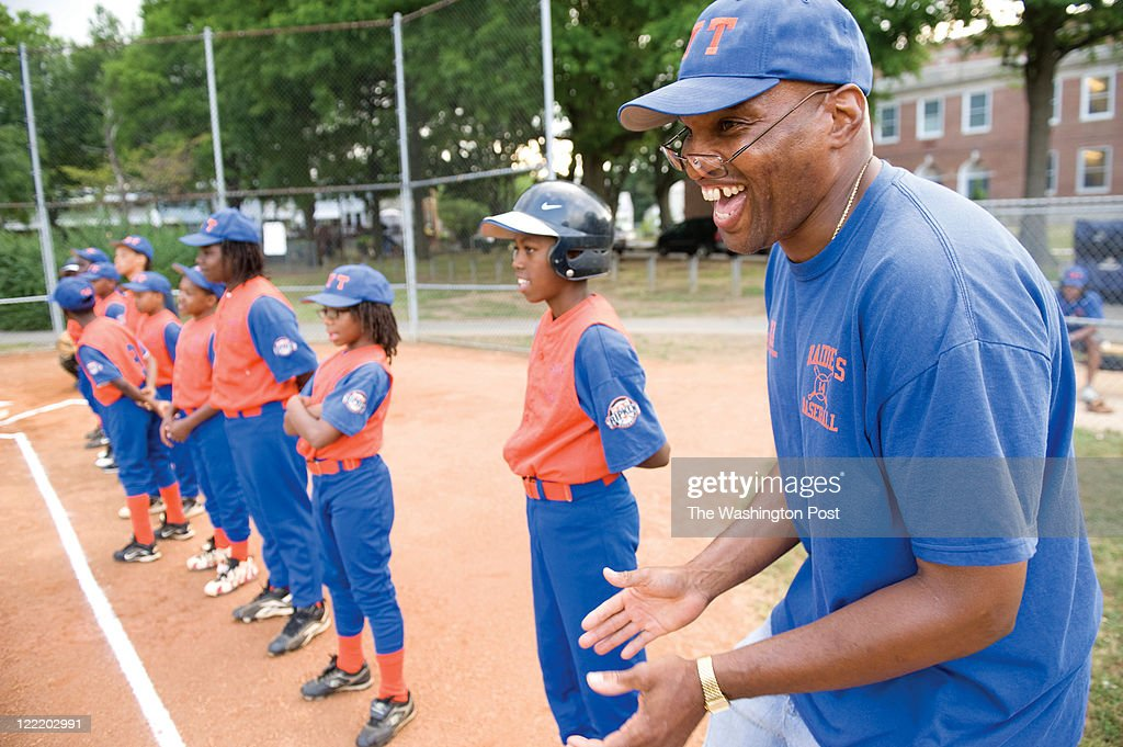 Head coach for the AYT #14 Raiders, Derrick McCrae, right, is all smiles before his team took on the King Greenleaf White Sox in a championship game at the Taft Recreation Center on Friday June 17, 2011 in Washington, DC. The King Greenleaf White Sox won 8-1. This game was in the Cal Ripken Division of the Babe Ruth League.
