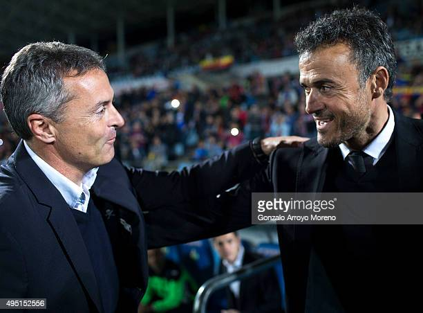 Head coach Fran Escriba of Getafe CF embraces head coach Luis Enrique Martinez of FC Barcelona during the La Liga match between Getafe CF and FC...