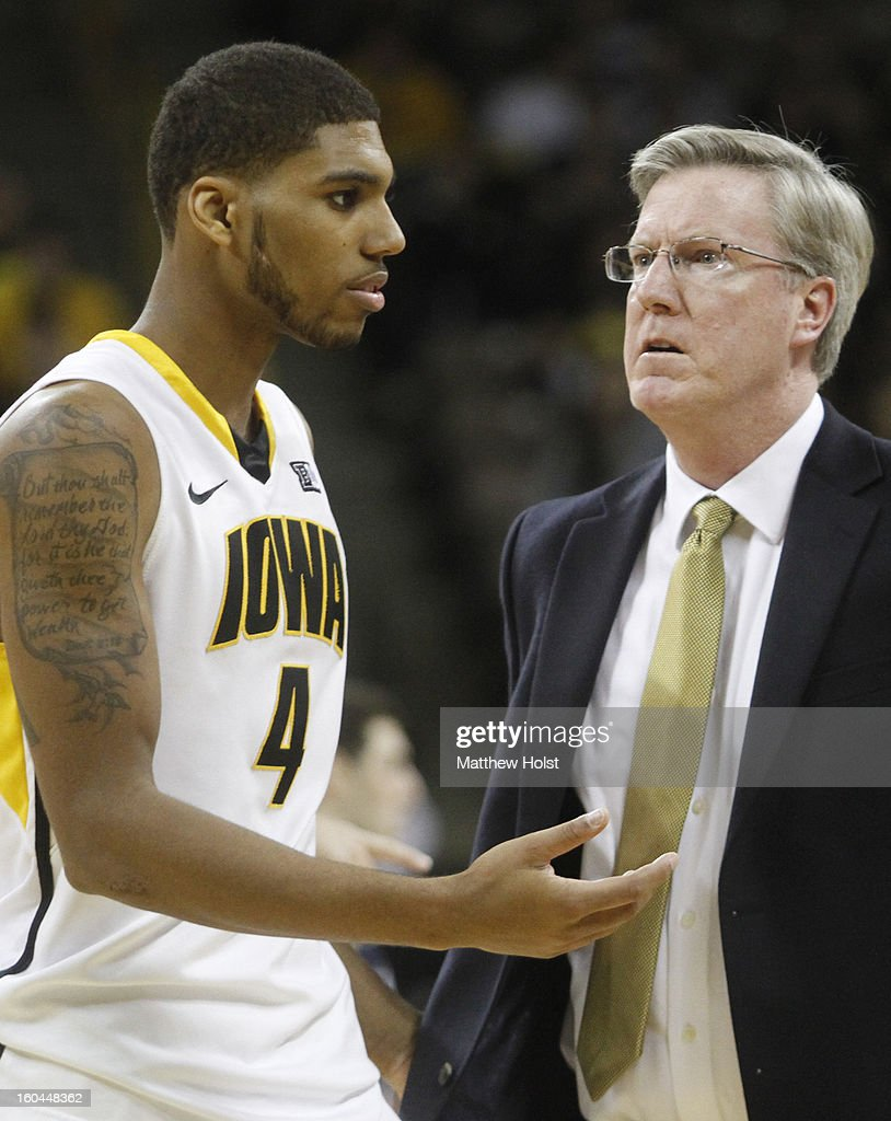 Head coach Fran McCaffery of the Iowa Hawkeyes confronts guard Roy Devyn Marble #4 during the second half against the Penn State Nittany Lions on January 31, 2013 at Carver-Hawkeye Arena in Iowa City, Iowa.