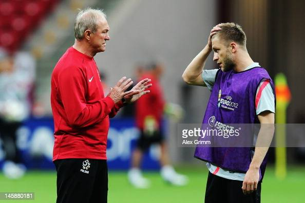 Head coach Franciszek Smuda of Poland talks to Jakub Blaszczykowski during a Poland training session ahead of the UEFA EURO 2012 Group A match...