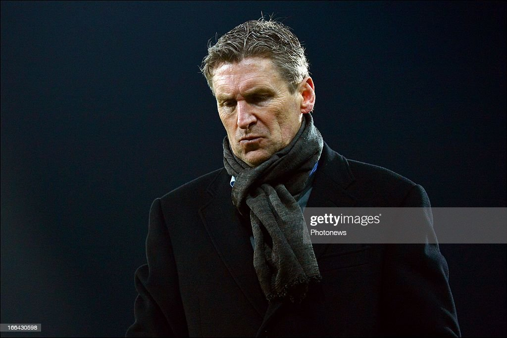 Head coach Francky Dury of Zulte-Waregem shows dejection after losing the Jupiler League match play-off 1 between Zulte Waregem and Standard de Liege on April 12, 2013 in Waregem, Belgium.