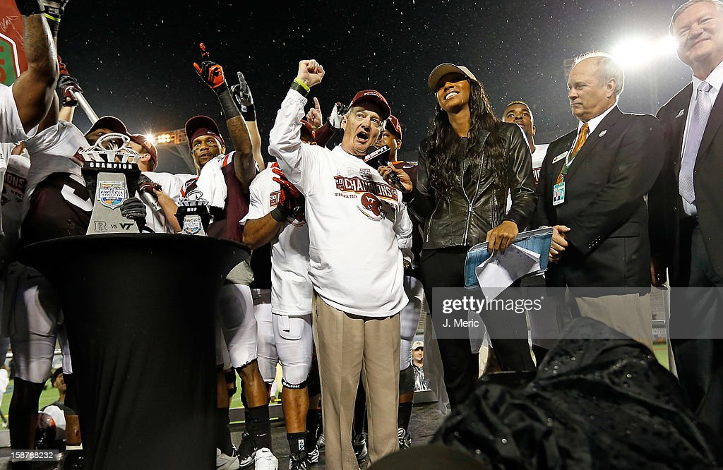 Head coach <a gi-track='captionPersonalityLinkClicked' href=/galleries/search?phrase=Frank+Beamer&family=editorial&specificpeople=234759 ng-click='$event.stopPropagation()'>Frank Beamer</a> of the Virginia Tech Hokies salutes the fans after the victory over the Rutgers Scarlet Knights during the Russell Athletic Bowl Game at the Florida Citrus Bowl on December 28, 2012 in Orlando, Florida.
