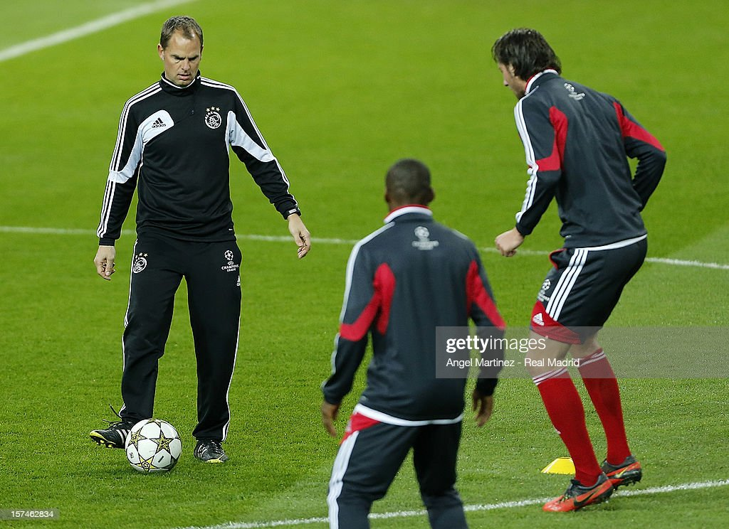 Head coach Frank de Boer (L) of AFC Ajax with the ball during a training session ahead of their UEFA Champions League group stage match against Real Madrid at Estadio Santiago Bernabeu on December 3, 2012 in Madrid, Spain.