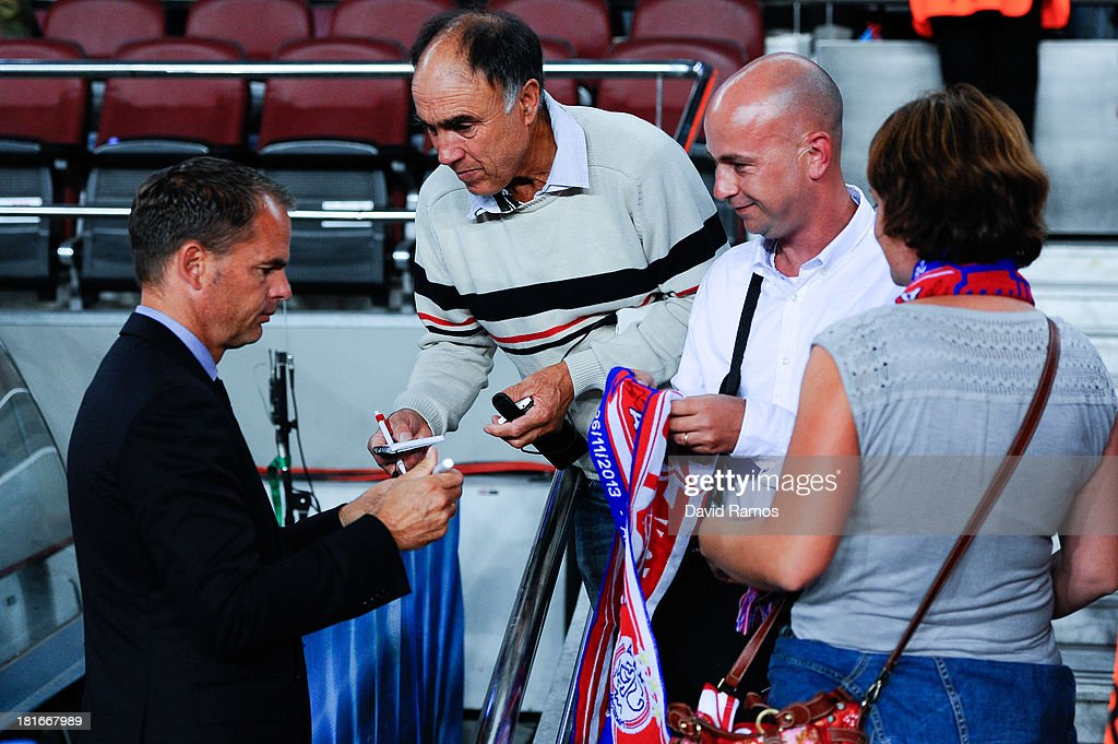 Head Coach <a gi-track='captionPersonalityLinkClicked' href=/galleries/search?phrase=Frank+De+Boer&family=editorial&specificpeople=1006742 ng-click='$event.stopPropagation()'>Frank De Boer</a> of Ajax Amsterdam signs autographs prior to the UEFA Champions League Group H match between FC Barcelona and Ajax Amsterdam at the Camp Nou stadium on September 18, 2013 in Barcelona, Spain.