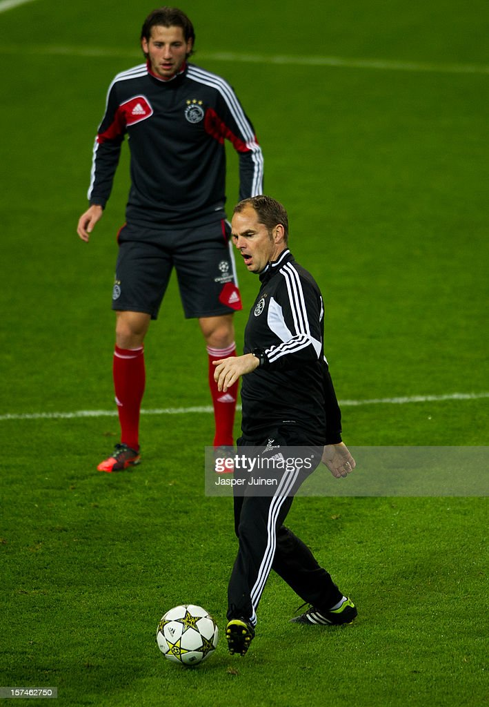 Head coach Frank De Boer (R) of Ajax controls the ball during a training session ahead of the UEFA Champions League match between AFC Ajax and Real Madrid CF at the Estadio Santiago Bernabeu on December 3, 2012 in Madrid, Spain.