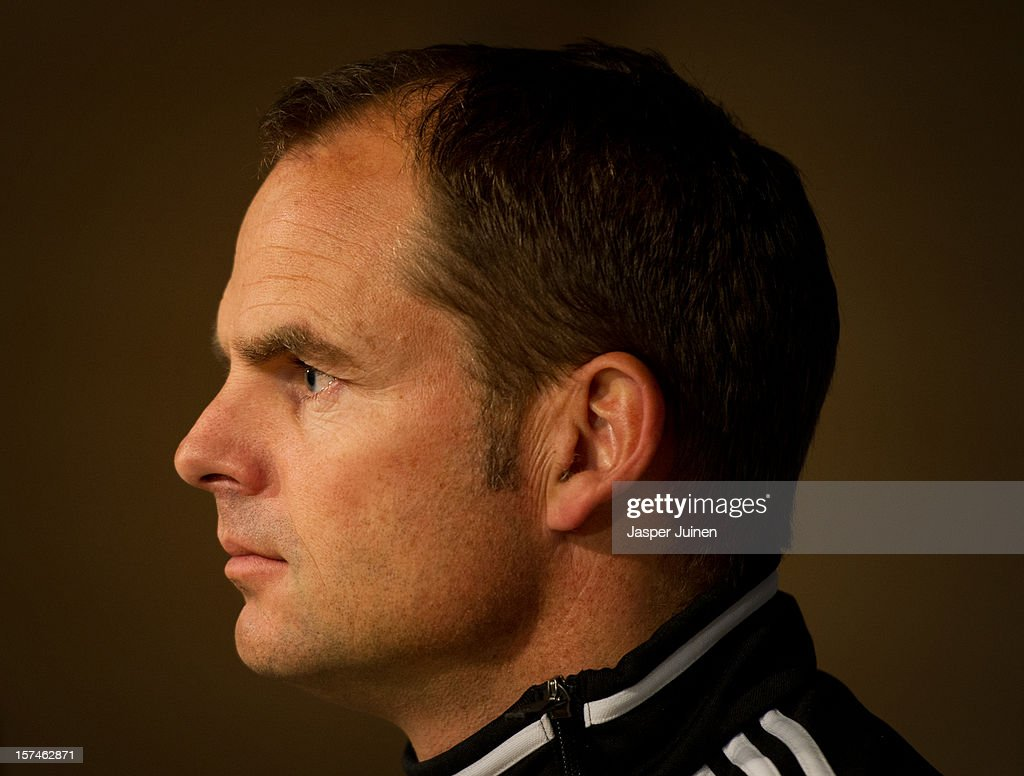 Head coach <a gi-track='captionPersonalityLinkClicked' href=/galleries/search?phrase=Frank+De+Boer&family=editorial&specificpeople=1006742 ng-click='$event.stopPropagation()'>Frank De Boer</a> of Ajax listens to questions from the media during a press conference ahead of the UEFA Champions League match between AFC Ajax and Real Madrid CF at the Estadio Santiago Bernabeu on December 3, 2012 in Madrid, Spain.