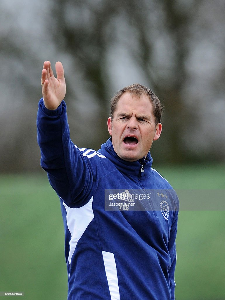 Head coach <a gi-track='captionPersonalityLinkClicked' href=/galleries/search?phrase=Frank+De+Boer&family=editorial&specificpeople=1006742 ng-click='$event.stopPropagation()'>Frank De Boer</a> of Ajax reacts to his players during a training session ahead of the Europa League match between Ajax and Manchester United at De Toekomst training ground on February 15, 2012 in Amsterdam, Netherlands.