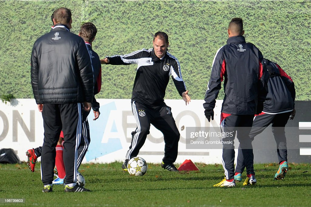 Head coach Frank de Boer of Amsterdam practices with Amsterdam players during a training session ahead of the UEFA Champions League match against Borussia Dortmund on November 20, 2012 in Amsterdam, Netherlands.