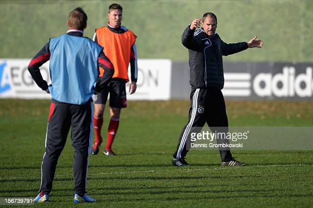 Head coach Frank de Boer of Amsterdam reacts during a training session ahead of the UEFA Champions League match against Borussia Dortmund on November...