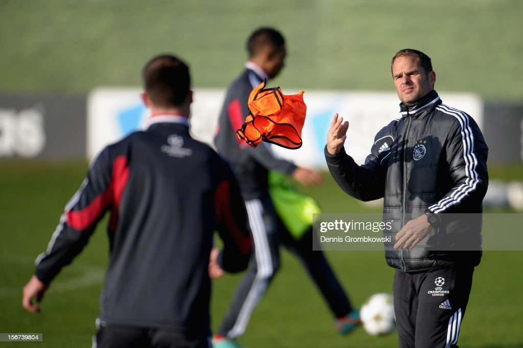 Head coach Frank de Boer of Amsterdam throws a bib during a training session ahead of the UEFA Champions League match against Borussia Dortmund on November 20, 2012 in Amsterdam, Netherlands.