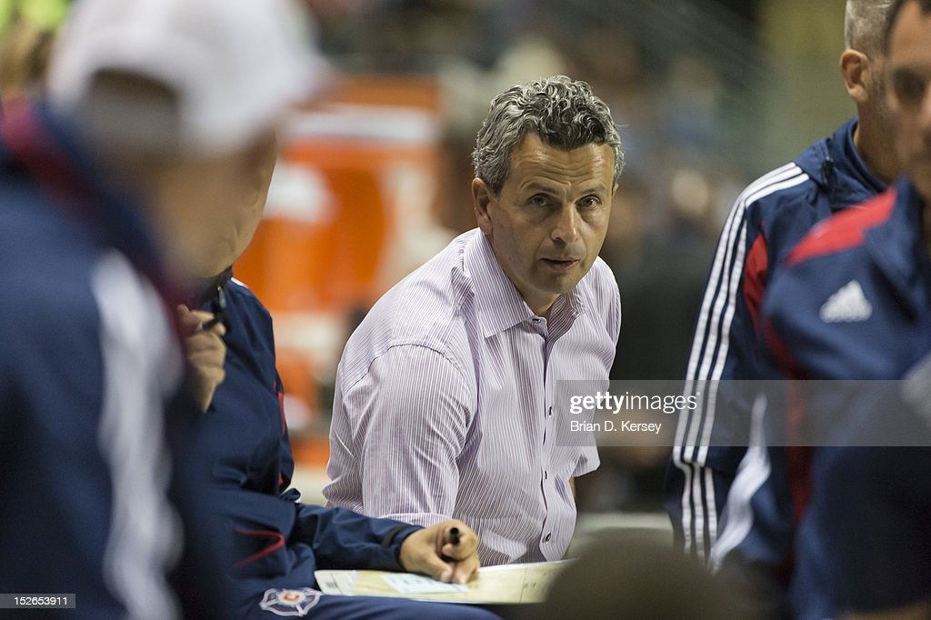 Head coach Frank Klopas of Chicago Fire talks to his assistants against the Montreal Impact at Toyota Park on September 15, 2012 in Bridgeview, Illinois. The Fire defeated the Impact 3-1.