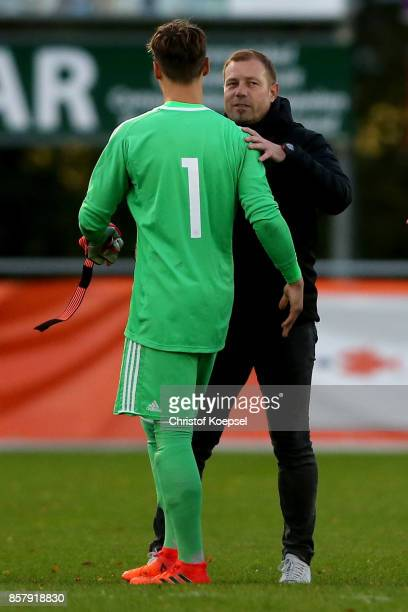 Head coach Frank Kramer of Germany shake hands with Constantin Frommann after the International friendly match between U20 Netherlands and U20...