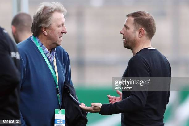 Head coach Frank Kramer of Germany talks to DFB sport director Horst Hrubesch after the UEFA Elite Round match between Germany U19 and Slovakia U19...