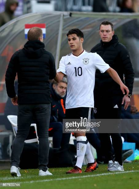 Head coach Frank Kramer shake hands with goalgetter Goerkem Saglam of Germany after his substitution during the International friendly match between...