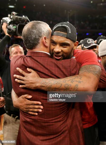 Head coach Frank Martin and Sindarius Thornwell of the South Carolina Gamecocks celebrate after defeating the Florida Gators with a score of 77 to 70...