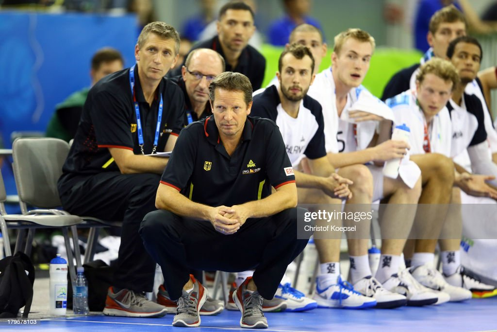 Head coach Frank Menz of Gemany and his team look dejected during the FIBA European Championships 2013 first round group A match between Germany and Belgium at Tivoli Arena on September 5, 2013 in Ljubljana, Slovenia.