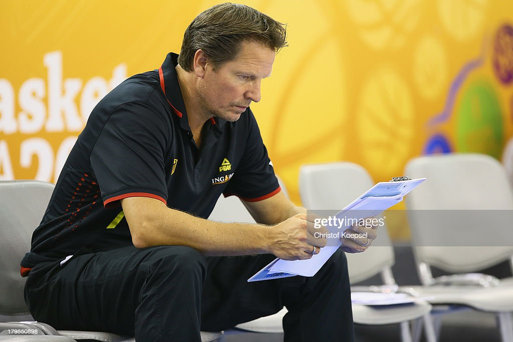Head coach Frank Menz of Gemany reads the team list prior to the FIBA European Championships 2013 first round group A match between France and Germany at Tivoli Arena on September 4, 2013 in Ljubljana, Slovenia.