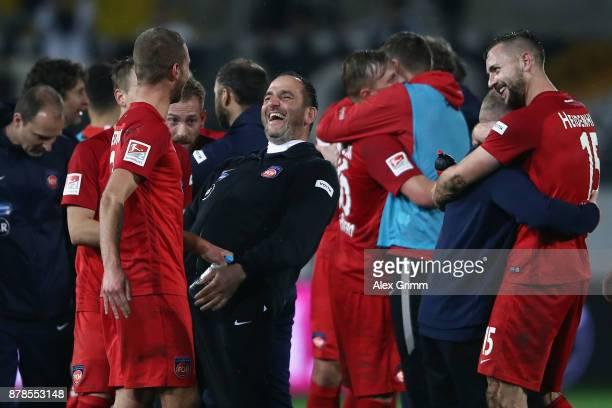 Head coach Frank Schmidt of Heidenheim celebrates with the team after the Second Bundesliga match between SV Sandhausen and 1 FC Heidenheim 1846 at...