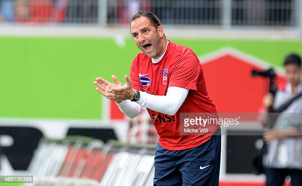 Head coach Frank Schmidt of Heidenheim reacts during the Third League match between 1 FC Heidenheim and SpVgg Unterhaching at VoithArena on May 10...