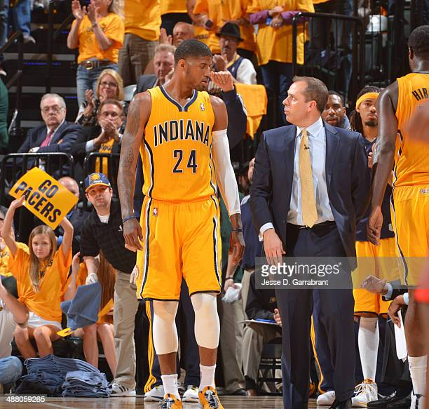 Head coach Frank Vogel and Paul George of the Indiana Pacers speak during game Seven of the Eastern Conference Playoffs against the Atlanta Hawks at...