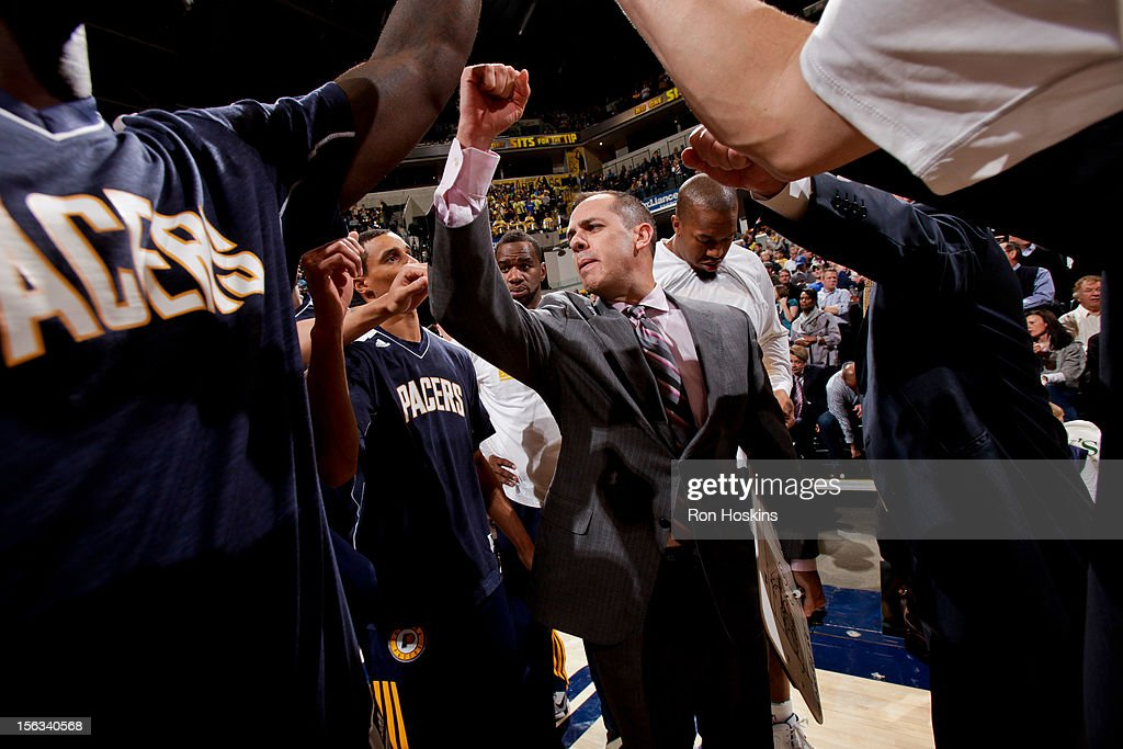 Head Coach Frank Vogel of the Indiana Pacers huddles up with his team before a game against the Toronto Raptors on November 13, 2012 at Bankers Life Fieldhouse in Indianapolis, Indiana.