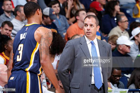 Head coach Frank Vogel of the Indiana Pacers talks to George Hill during the game against the Cleveland Cavaliers at Cintas Center on October 15 2014...