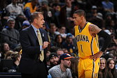 Head Coach Frank Vogel of the Indiana Pacers talks with Joe Young of the Indiana Pacers during the game against the Denver Nuggets on January 17 2016...