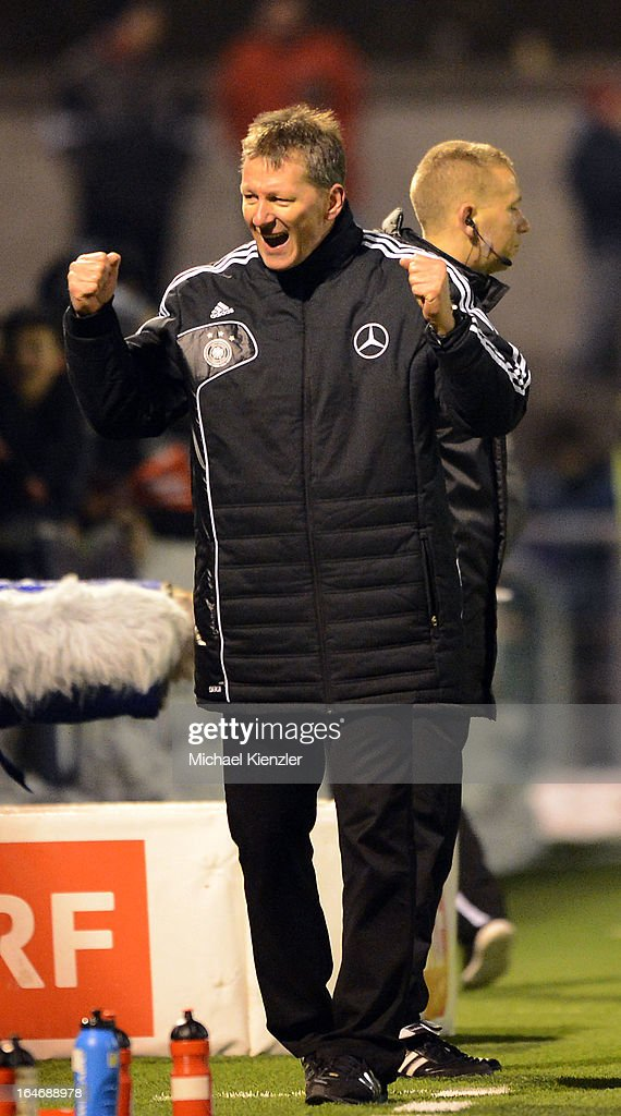 Head coach Frank Wormuth of Germany celebrates after the international friendly match between U20 Switzerland and U20 Germany at Eps Stadium on March 26, 2013 in Baden, Switzerland