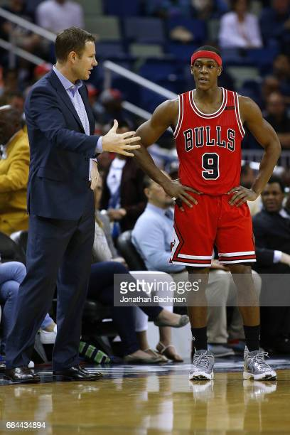 Head coach Fred Hoiberg of the Chicago Bulls and Rajon Rondo react during the first half of a game against the New Orleans Pelicans at the Smoothie...