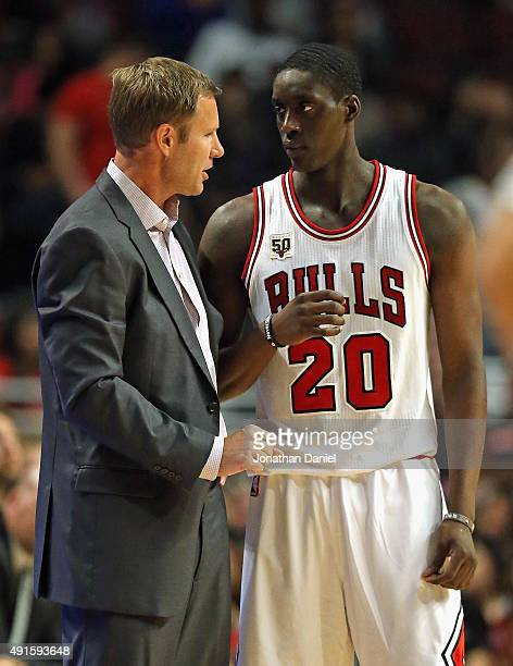 Head coach Fred Hoiberg of the Chicago Bulls gives instructions to Tony Snell during a preseason game against the Milwaukee Bucks at the United...
