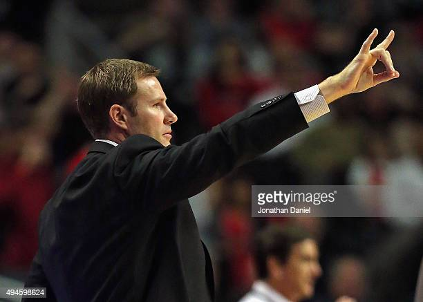 Head coach Fred Hoiberg of the Chicago Bulls signals to his team during the season opening game against the Cleveland Cavaliers at the United Center...