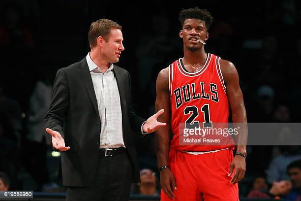 Head coach Fred Hoiberg of the Chicago Bulls talks with Jimmy Butler against the Brooklyn Nets during the first half at Barclays Center on October 31...