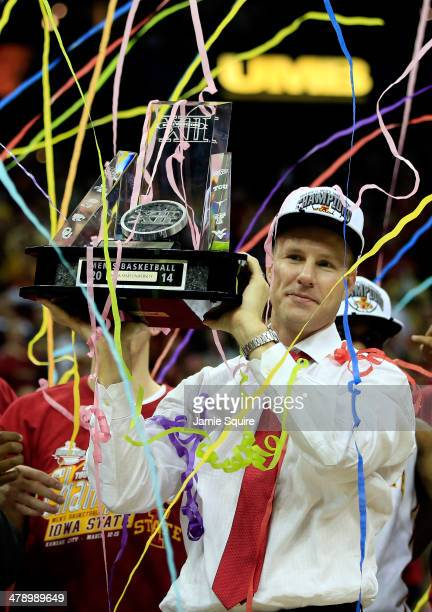 Head coach Fred Hoiberg of the Iowa State Cyclones holds up the trophy after winning the 2014 Big 12 Men's Championship over the Baylor Bears at the...