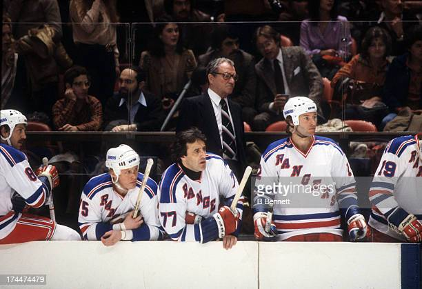 Head coach Fred Shero and Phil Esposito of the New York Rangers look on from the bench during an NHL game in October 1978 at the Madison Square...