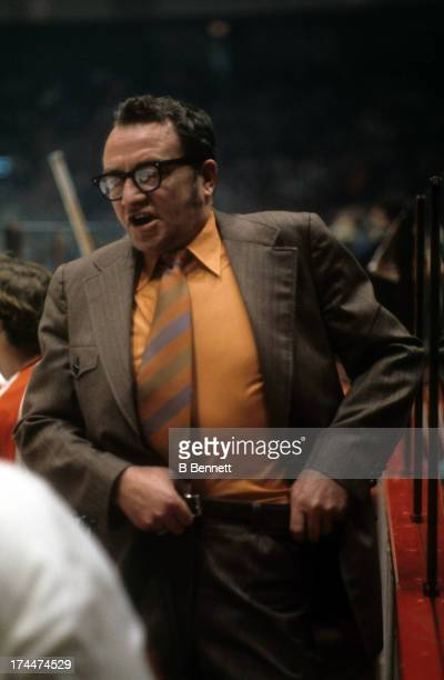 Head coach Fred Shero of the Philadelphia Flyers looks on from the bench during an NHL game circa 1974