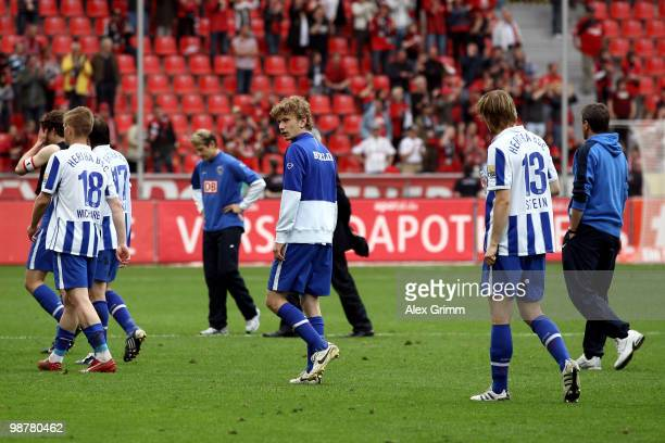 Head coach Friedhelm Funkel and players of Berlin leave the pitch after loosing the Bundesliga match between Bayer Leverkusen and Hertha BSC Berlin...