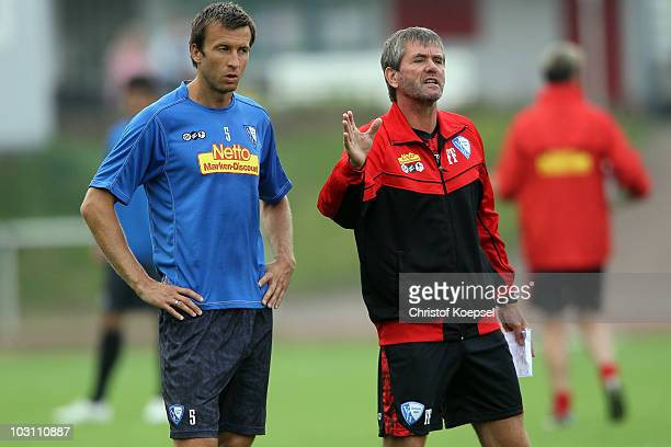 Head coach Friedhelm Funkel issues instructions to Christoph Dabrowski during the VfL Bochum training session at the Bib Arena on July 27 2010 in...