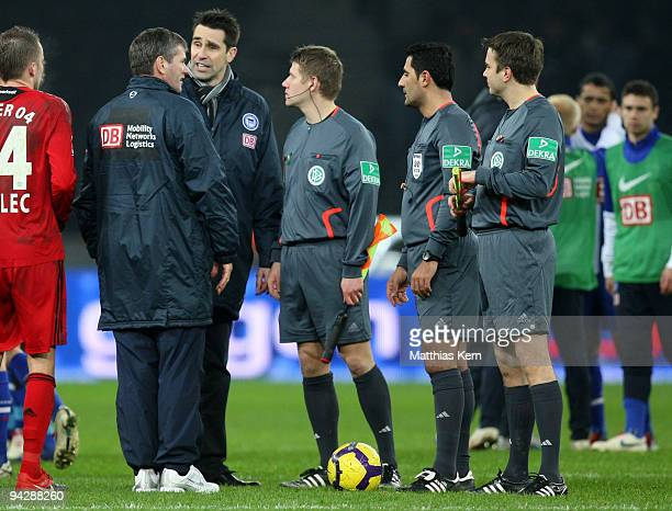 Head coach Friedhelm Funkel manager Michael Preetz and referee Babak Rafati discuss after the Bundesliga match between Hertha BSC Berlin and Bayer 04...