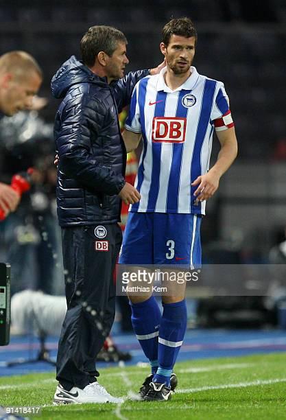 Head coach Friedhelm Funkel of Berlin speaks with Arne Friedrich during the Bundesliga match between Hertha BSC Berlin and Hamburger SV at Olympic...