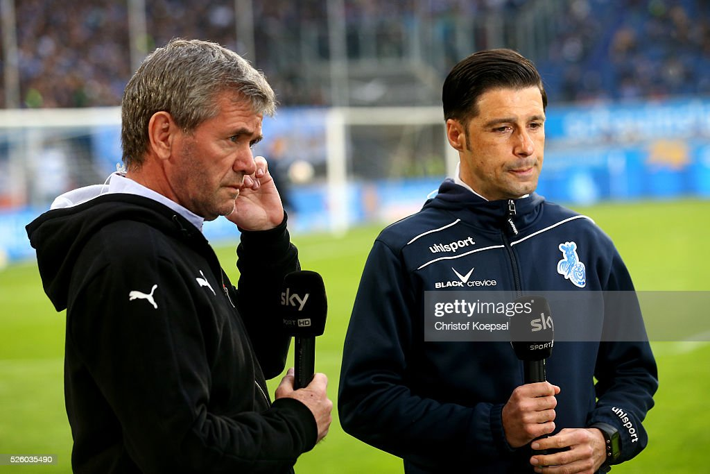 Head coach <a gi-track='captionPersonalityLinkClicked' href=/galleries/search?phrase=Friedhelm+Funkel&family=editorial&specificpeople=649153 ng-click='$event.stopPropagation()'>Friedhelm Funkel</a> of Duesseldorf and head coach Ilia Gruev of Duisburg talk to sky television channel prior to the 2. Bundesliga match between MSV Duisburg and Fortuna Duesseldorf at Schauinsland-Reisen-Arena on April 29, 2016 in Duisburg, Germany.