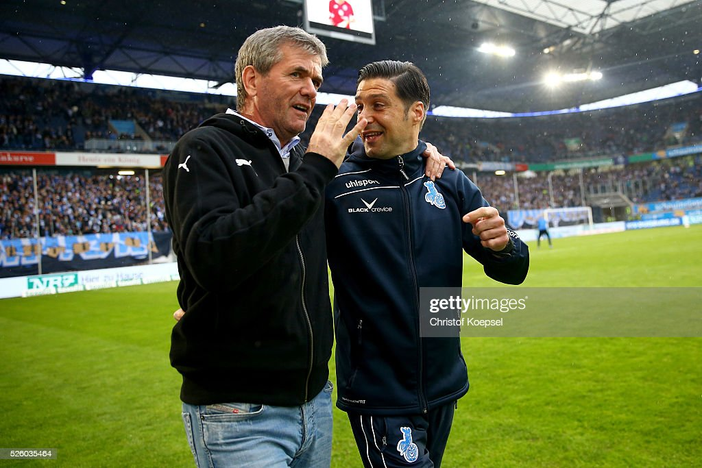 Head coach <a gi-track='captionPersonalityLinkClicked' href=/galleries/search?phrase=Friedhelm+Funkel&family=editorial&specificpeople=649153 ng-click='$event.stopPropagation()'>Friedhelm Funkel</a> of Duesseldorf and head coahc Ilia Gruev of Duisburg talk prior to the 2. Bundesliga match between MSV Duisburg and Fortuna Duesseldorf at Schauinsland-Reisen-Arena on April 29, 2016 in Duisburg, Germany.